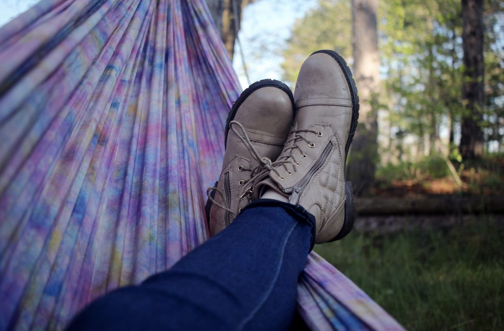 image of person laying in a hammock