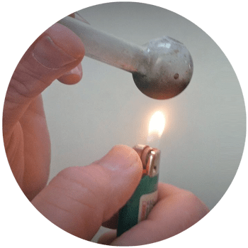 "image of a person hitting meth with dirty glass pipe and bic lighter for a blog article entitled ""Teenagers Exhibit Most Risk for Methamphetamine Side Effects"" for Gulf Breeze Recovery non 12 step holistic drug rehab"