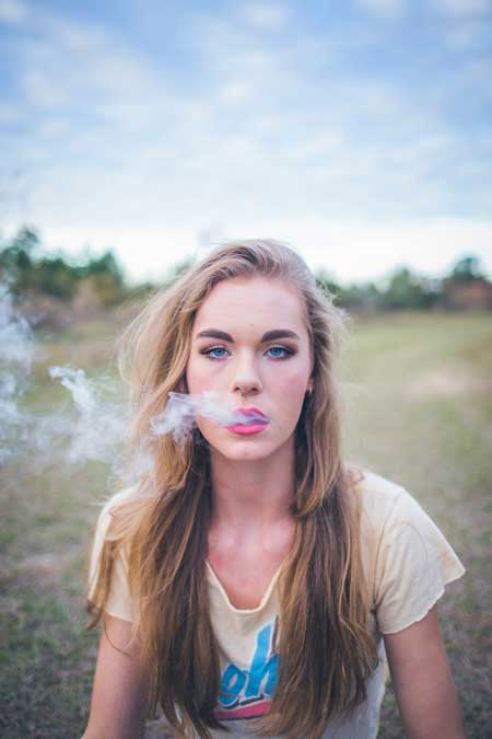 image of young person of college age using marijuana for news report of increased use for Gulf Breeze Recovery non-12 step holistic drug and alcohol rehab in Florida