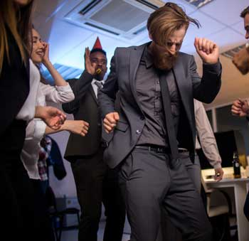 image of drunk guy dancing at holiday office party for article by Gulf Breeze Recovery non-12 step alcohol and drug rehab in Florida