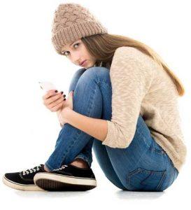 image of young girl sitting cross-legged