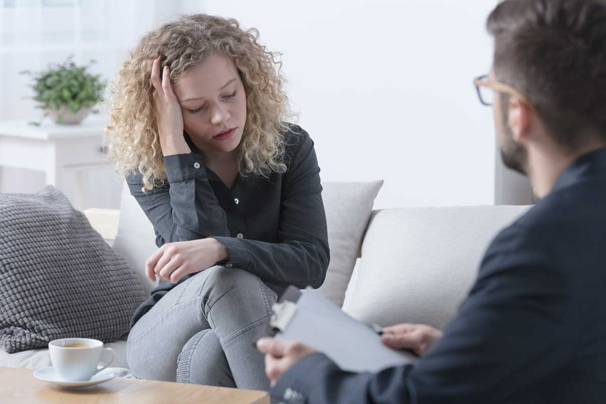 image of woman discussing trauma with therapist