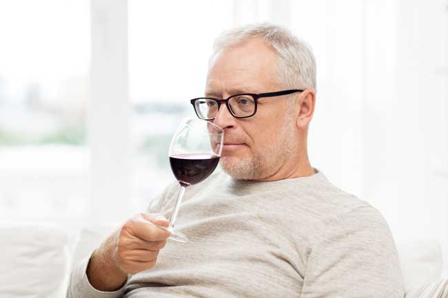 """man sipping wine """"Alcoholism Today in Seniors and Younger Generations"""""""